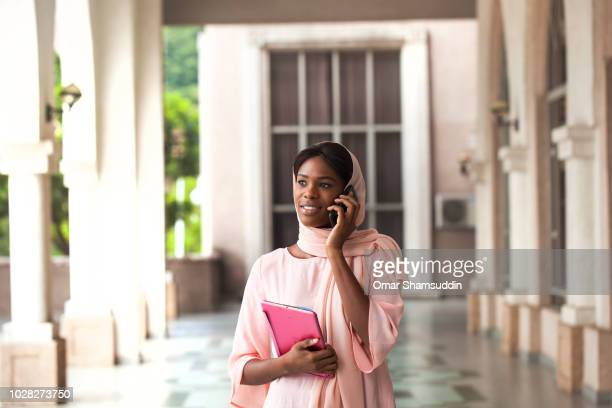 Young college student talking on the smartphone