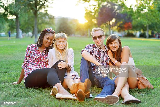 Young college students together in the park