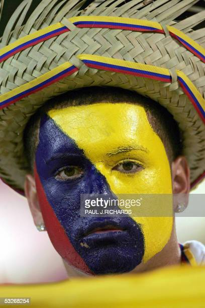 Young Colombian fan looks at the photographer prior to the match Colombia against Panama during the CONCAF Gold Cup semi-finals 21 July 2005 at...