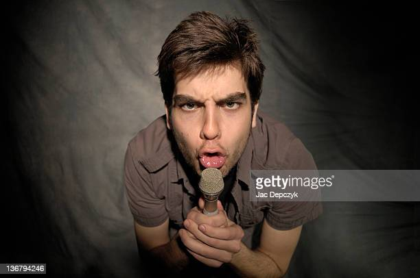young comic actor making strange noises - depczyk stock pictures, royalty-free photos & images