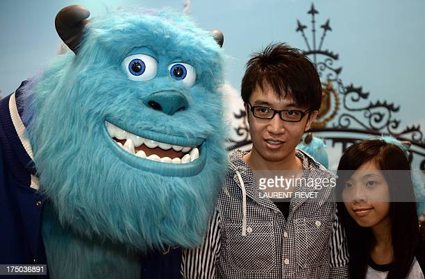 Young comic and animation cartoon fans pose with a a Disney character at the 15th AniCom and Games Fair in Hong Kong on July 30 2013 The annual...