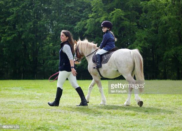 A young competitor is led to the showground to compete during the Duncombe Park Country Fair on May 28 2018 in Helmsley England Set in the grounds of...