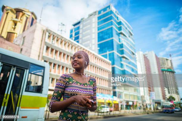 young confident african woman in city centre - tanzania stock pictures, royalty-free photos & images