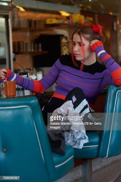 Young Confident Woman Hanging Out At A Diner