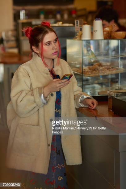 young confident woman in coffee shop - noapologiescollection stock pictures, royalty-free photos & images