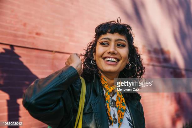 young confident woman smiling - lgbtq stock pictures, royalty-free photos & images