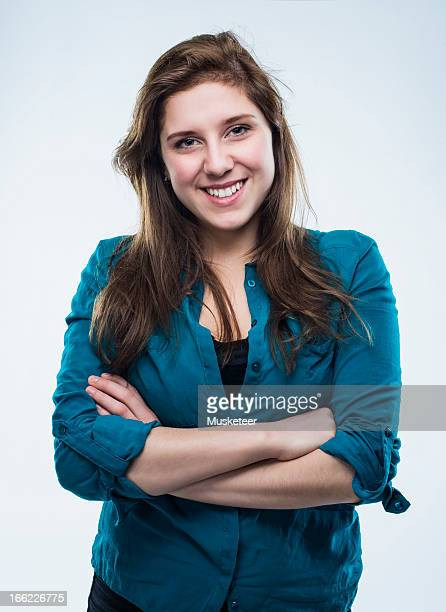 Young confident woman with crossed arms
