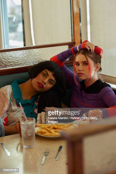 Young Confident Women Hanging Out At A Diner