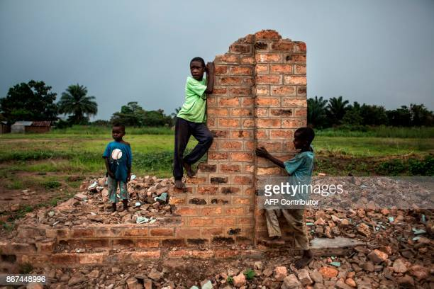 TOPSHOT Young Congolese boys play around broken building on October 26 2017 in Kasala in the restive region of Kasai central Democratic Republic of...