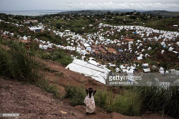 A young Congolese girl looks out over a camp for Internally Displaced Persons on March 20 2018 in Kalemie Democratic Republic of the Congo An ongoing...