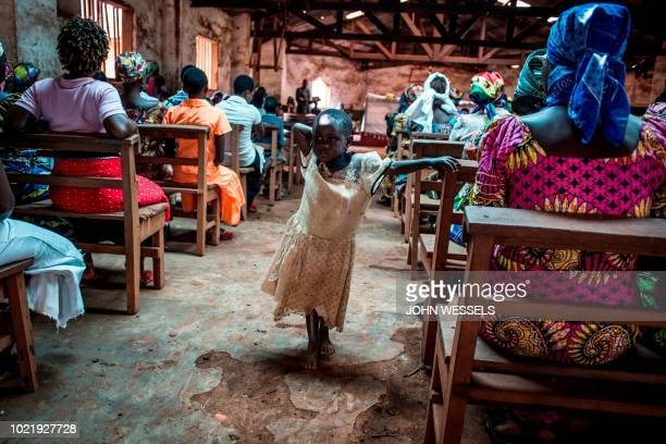 A young Congolese girl stands during a church service on August 19 2018 in Mangina near Beni in the North Kivu province Sixtyone people have died in...