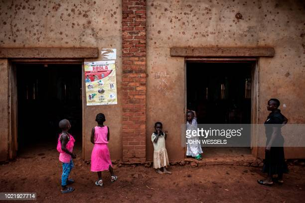 Young Congolese girls look at a poster explaining the symptoms of Ebola on August 19 2018 in Mangina near Beni in the North Kivu province Sixtyone...