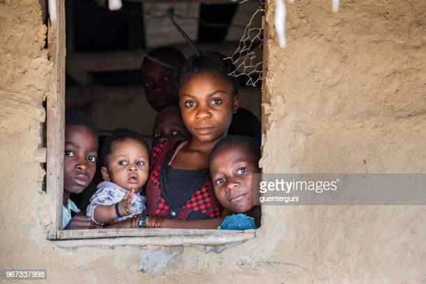 young congolese woman with her kids - democratic republic of the congo stock pictures, royalty-free photos & images