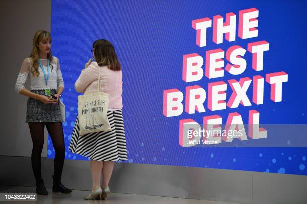 Young Conservative Party members chat next to a sign that says The Best Brexit Deal during the annual Conservative Party Conference on September 30...