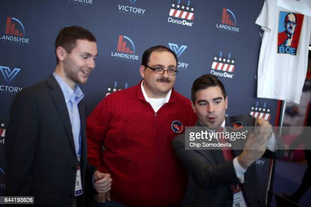 Young conservatives pose for photograph with Ken Bone who became a social media star after asking a question during the second presidential debate in...