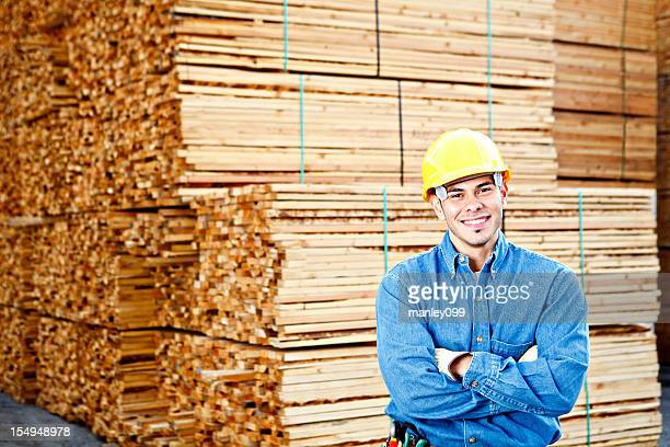 Young construction worker crossed armes smiling big