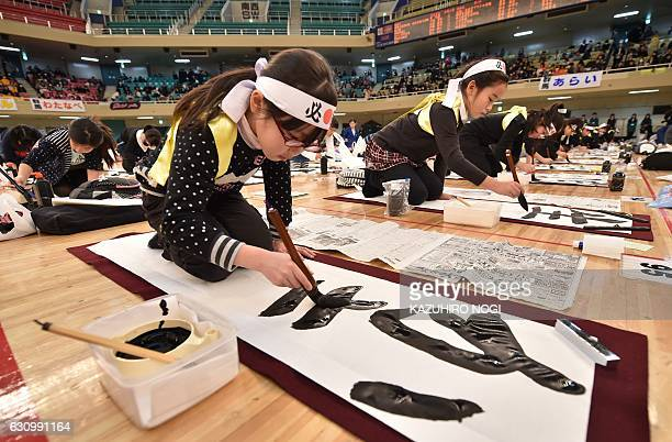 A young contestant writes calligraphy during the annual New Year calligraphy contest in Tokyo on January 5 2017 About 3000 people took part in the...