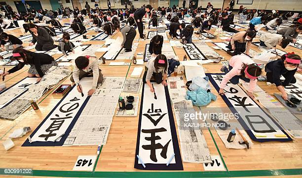 Young contestants write calligraphy during the annual New Year calligraphy contest in Tokyo on January 5 2017 About 3000 people took part in the...