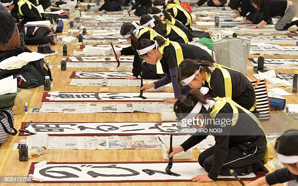 Young contestants write their calligraphy during the annual New Year calligraphy contest in Tokyo on January 5 2016 About 3000 people took part in...