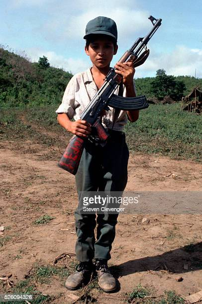 A young contra fighter stands at attention in a base camp located inside Honduras These child volunteer fighters would arrive at base camps...