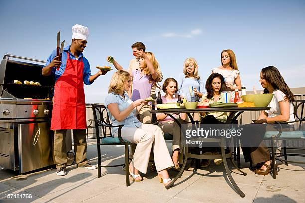 young cook and his friends together at a bbq party - penthouse girls stock pictures, royalty-free photos & images