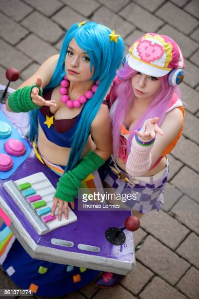Young cosplayer featuring 'Miss Fortuna' and 'Sona' pose the 2017 Frankfurt Book Fair on October 14 2017 in Frankfurt am Main Germany The 11th German...