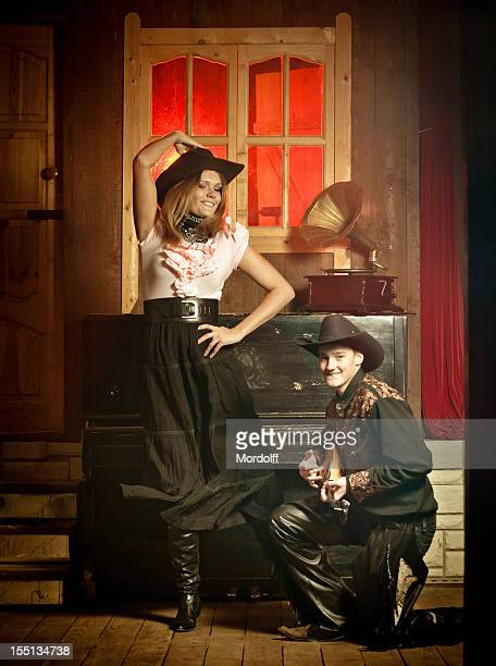 Young country western couple dancing in saloon
