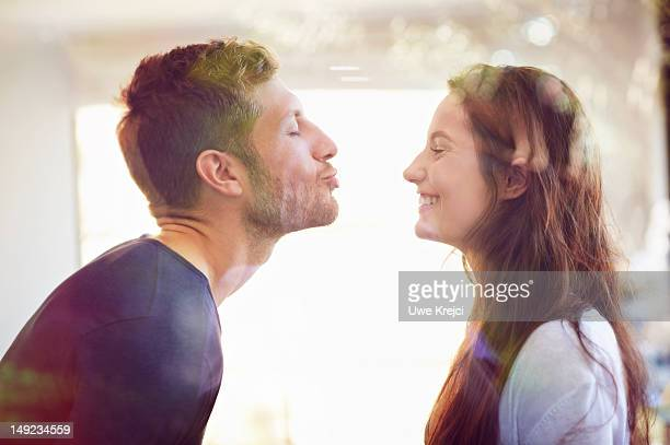 young couple about to kiss - kissing stock pictures, royalty-free photos & images