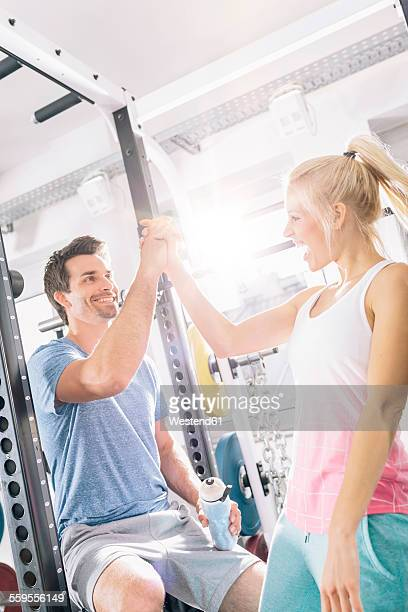 Young couple after training at gym
