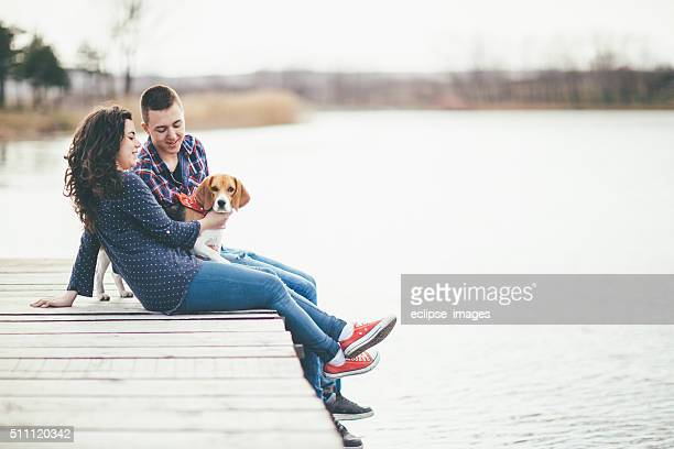 Young couple and a dog