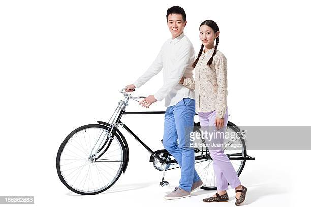 Young couple and bicycle in 1970s