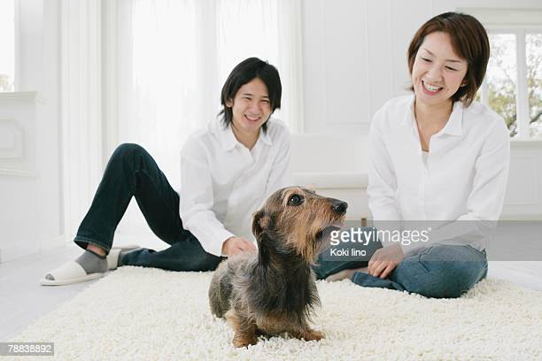 Young couple and Dachshund