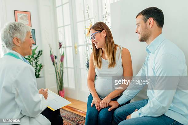 young couple and female doctor in a consultation. - human fertility stock pictures, royalty-free photos & images
