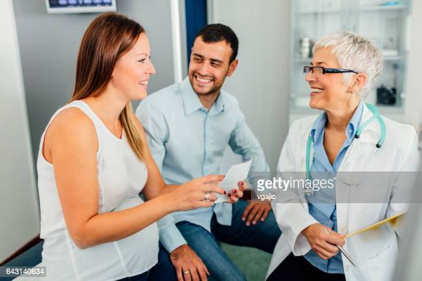 Young Couple And Female Doctor In A Consultation