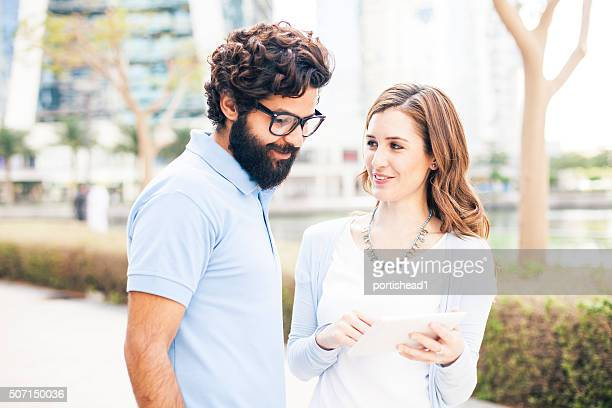 Young couple and tablet