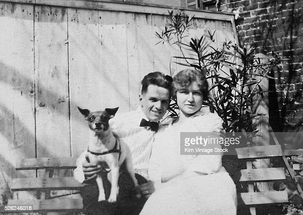 A young couple and their Jack Russell terrier ca 1925
