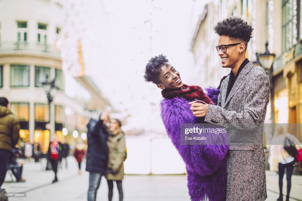 Young couple are having fun in the winter : Stock Photo