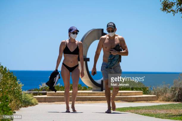 Young couple are seen at Cottesloe Beach wearing mandatory face masks after an hour of recreational exercise is permitted on February 01, 2021 in...
