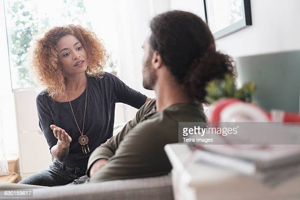 young couple arguing at home - couple arguing stock photos and pictures
