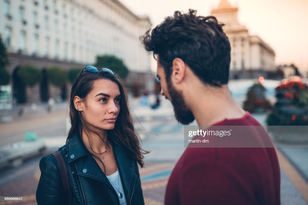Young couple arguing at the street : Stock Photo