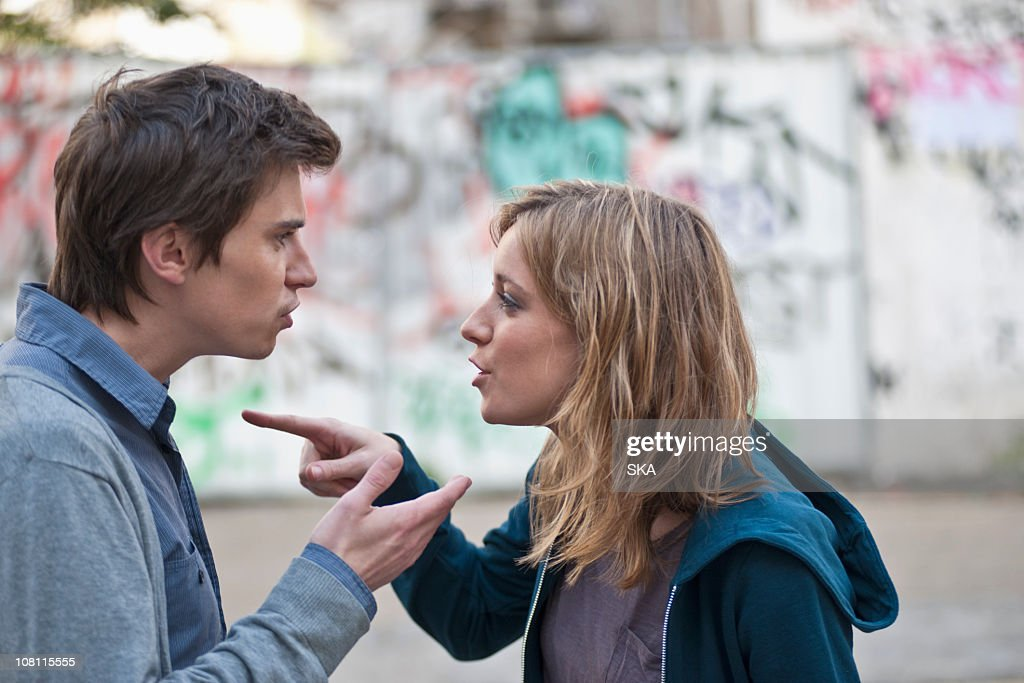Young couple arguing in street : Stock Photo