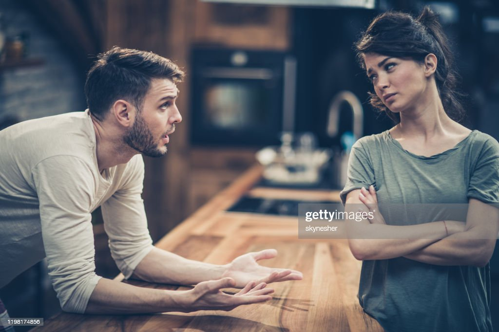 Young couple arguing while having problems in their relationship. : Stock Photo