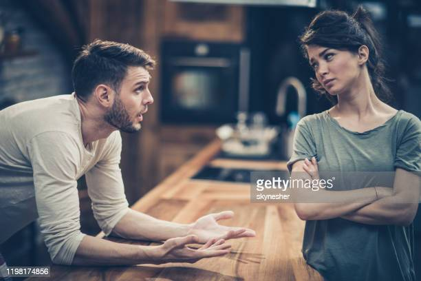 young couple arguing while having problems in their relationship. - ignoring stock pictures, royalty-free photos & images