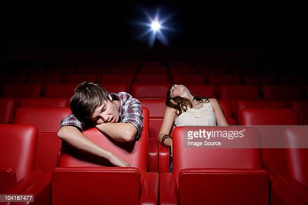 Young couple asleep in the movie theater