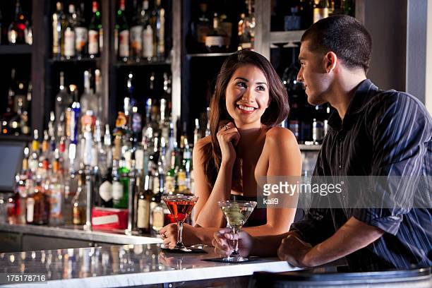 Young couple at a bar