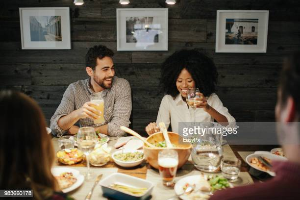 a young couple at a dinner party. - dineren stockfoto's en -beelden