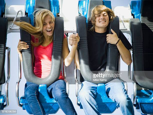 young couple at an amusement park