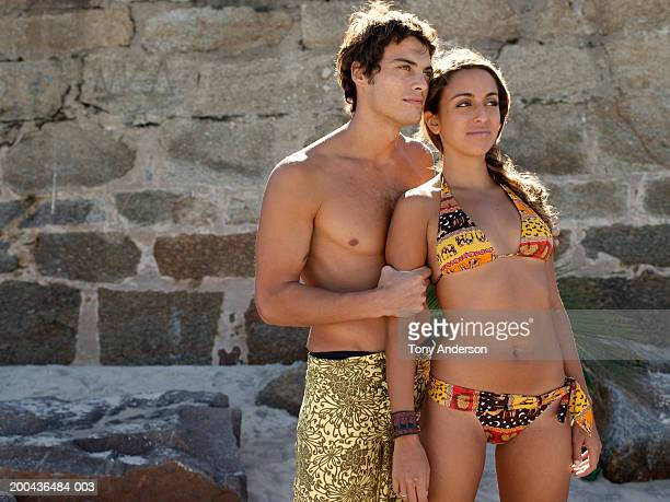young couple at beach, looking away - brazilian girls stock photos and pictures