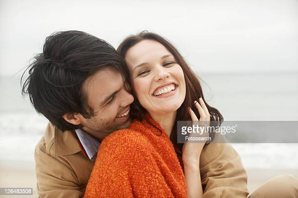Young couple at beach (portrait)