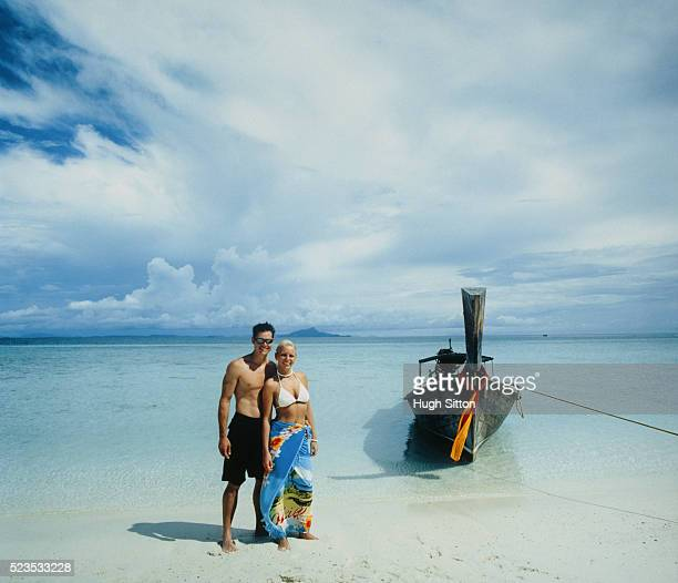 young couple at beach - hugh sitton stock-fotos und bilder